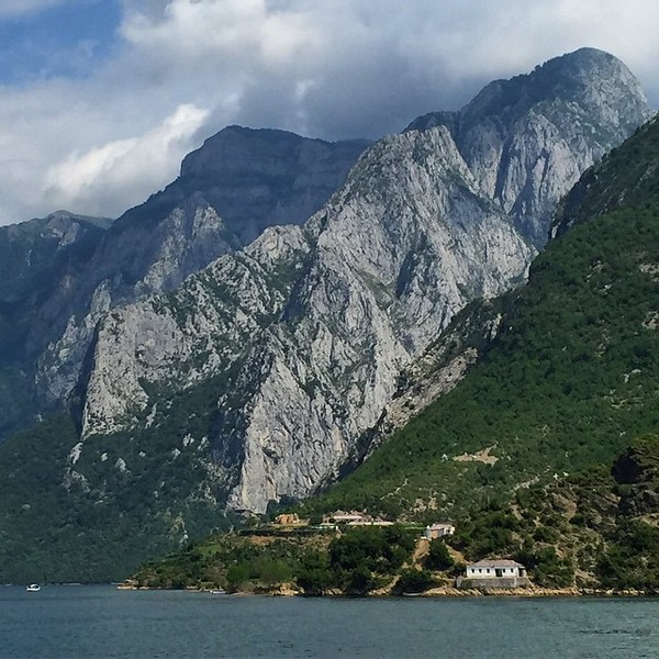 Komani Lake, Albania. We took the slow boat across, through the narrows, around the bends. 3 hours so we could soak up views like this. Photo selection today, a nearly impossible task. I also wonder what it's like to live in that house! This is Peaks of the Balkans. via Instagram http://ift.tt/1K2HFLz