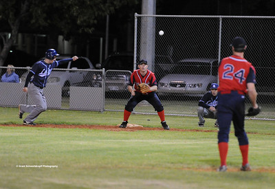 Nick Kuhn (Berri) places pressure on the Barmera runner as he throws in to 1st base