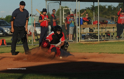 Kenny Karpenny Snr (Berri) steals home. Tristan Jackson (Lyrup) catcher sees the ball spill out and Kenny is home.