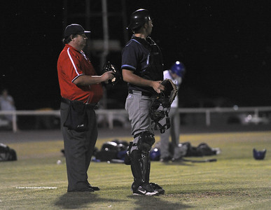 Barmera catcher Jason McGregor gives directions. Umpire Peter Brown looks on.