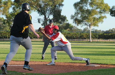 Jarrad Cranmer (Loxton) strides out to 1st base as Jason Trew (Lyrup) waits for ball