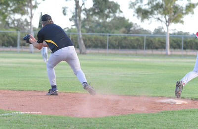 Mark Newmann (Loxton) waits for ball on 1st base