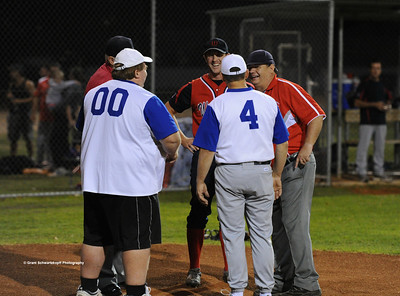 Managers and umpires discuss the game before the start