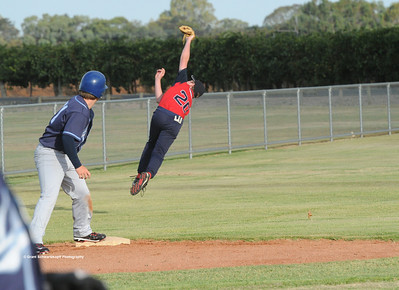 Jesse Frazer (Berri) makes a spectacular attempt to drag in a catch on 3rd base.