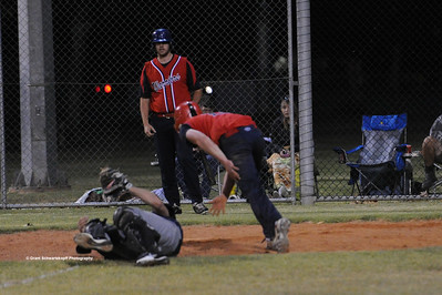 Hayden Sanford (Barmera) takes a hit by Berri runner coming home.