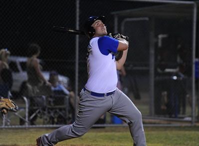 Dave Grenfell (Renmark) looks skyward as the ball flies off the bat