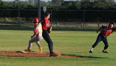 Tristan (Twiggy) Jackson (Lyrup) safe on 2nd base. Mitchel Crosbie (Berri) watches as Kenny Karpenny Jnr (Berri) stops the ball.
