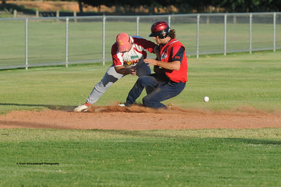 Matt Recchia (Lyrup) attempts to tag out Con Geromichalos (Berri) at 3rd base.