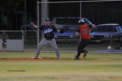 Phil Goldspink(Berri) tries to make it to 1st base. Jason McGregor (Barmera ) waits for ball.