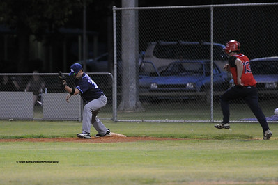 Paul Reid(Berri) tries to make it to 1st base. Jason McGregor (Barmera ) waits for ball.