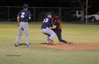 Peter Moritz (Berri) crashes into 2nd base player for Barmera Ben Clever