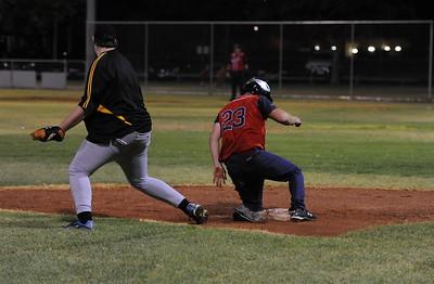 Phil Goldspink (Berri) slides into 3rd base as Jarrod Cramner (Loxton) waits for ball