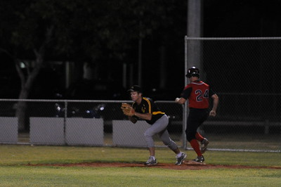 Split decision. Nick Kuhn (Berri) touches 1st base as Mark Moore (Loxton) takes the ball in the glove.