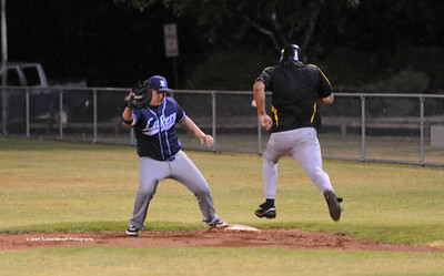 Mark Neuman (Loxton) strides out for 1st base. Jesse Stemberger (Barmera) waits for the ball.
