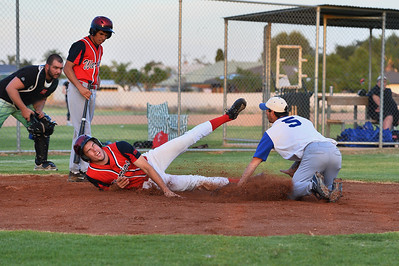 Daniel Gilgen (Renmark) tries to tag out the Berri runner as he slides into home plate
