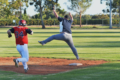 Jason Bowers (Barmera) jumps for the ball as  Matt Cutting (Berri) heads for 1st
