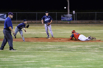 Jordan Walker (Barmera) stops the ball at short stop and throws to 1st base as Ashley Rogers (Berri) slides into 2nd