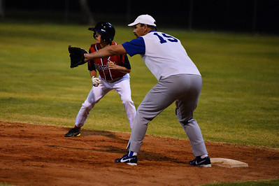 Kenny Karpany (Berri) ready to leave 1st base as Kevin McDonald  (Renmark) waits for the ball