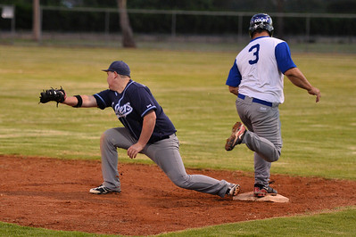 Dave Grenfell (Renmark) safe at 1st as Jesse Stemberger (Barmera) takes the ball