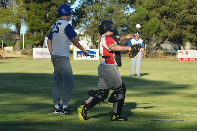 """Dylan Blackley (Renmark) at bat, watches as Tristan """"Twiggy"""" Jackson returns the ball."""