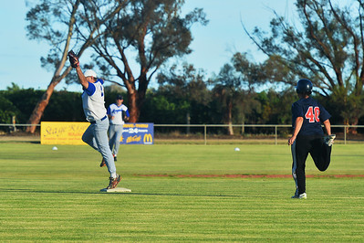 Allan Selfe (Renmark) jumps to take the ball to run out Taylee Healy (Lyrup)