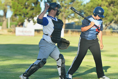 Taylee Healy (Lyrup) at bat Dale Broughton (Renmark) returns the ball