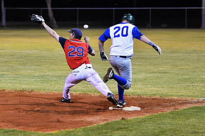 A Job (Renmark) tries to beat the ball to the glove of Berri first baseman, Steven Goldspink