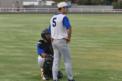 Graham Solly (Renmark catcher) discusses game tactics with pitcher Dan Gilgen
