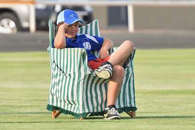 Hamish McDonald relaxing while watching the baseball