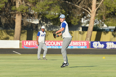Warren Beer (Renmark) in the outfield as  Dylan Blackley (Renmark) prepares to throw to 2nd base