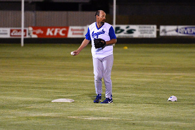 Kevin McDonald (Renmark) loses his hat after  after stopping a hard drive from a Berri batter