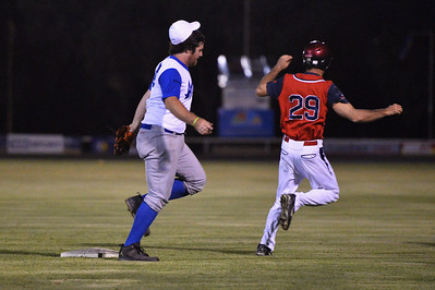 Steven Goldspink (Berri) tagged out at 1st base by Dion Tregeagle (Renmark)