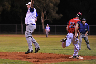 Travis McLean (Renmark) jumps to get ball as Steven Goldspink (Berri) runs to 1st base