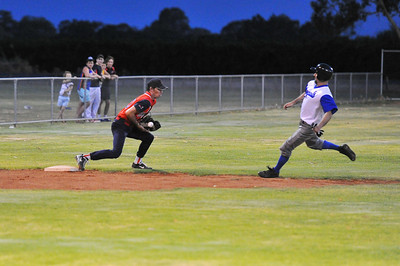 Doug Hren (Renmark) prepares to slide into 3rd base