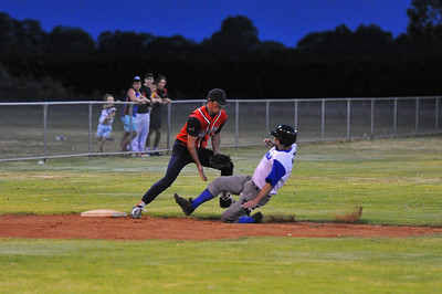 Doug Hren (Renmark) slides into 3rd base as ball is now between Dougs legs.