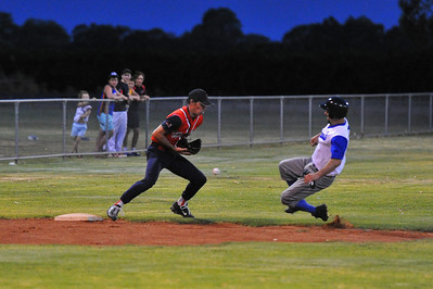 Doug Hren (Renmark) prepares to slide into 3rd base as Berri player fumbles the ball.