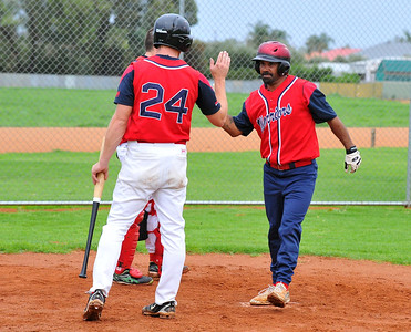 Kenny Karpany Snr (Berri A) gets a high 5 from Berri A captain/coach Nick Kuhn for the home run