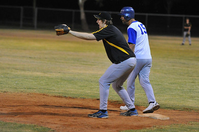 Jarrad Cranmer (Loxton) on 1st base waits for the ball as Kevin McDonald (Renmark) prepares to steal