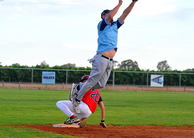 Kev McDonald (Renmark) jumps for the ball on third base
