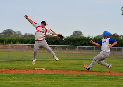 Matt Recchia (Lyrup) jumps to take the return to third base as Brad Healy(Renmark) strides in