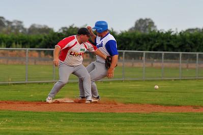 Matt Recchia (Lyrup) on third base as Brad Healy(Renmark) strides in