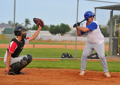 Shane Healy (Renmark) at bat with Jerome Riemers (Lyrup) catching