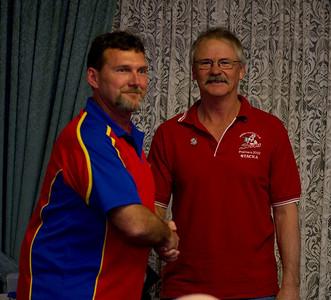 Shane Healy (Life member) congratulates Rick Frahn (Renmark, Paringa) on gaining Life Membership