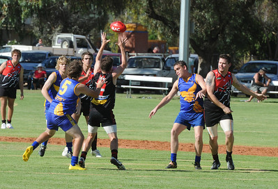 Troy Cowland (2) for BSR reaches for the ball as Tyson Maynard (5)  for Cobby applies the pressure.