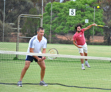 Ash Couzens (Waikerie) serves with Luke Taylor (Waikerie) waits