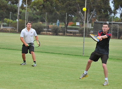 Nathan Flight (Loxton) watches as Dale Sterling (Loxton) returns the ball