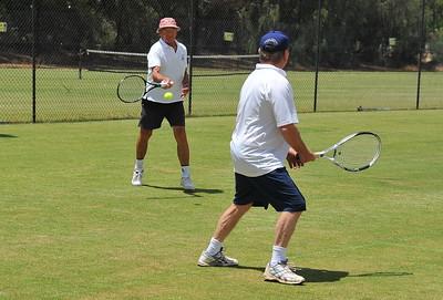 Colin Lindner (Pink hat) returns serve