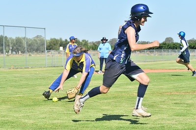 Cara Venning (Loxton) heads to 1st base as Jo Gregory (Cobby) picks up the ball to throw