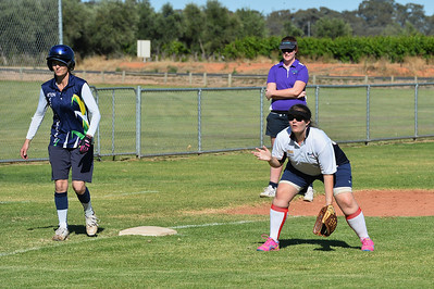 Brooke Matcham (Berri) waits for the pitch as Cara Venning (Loxton) prepares to steal home.