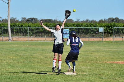 Naomi Taylor (Berri) stretches for the ball as Cara Venning (Loxton) makes it safely to 2nd.
